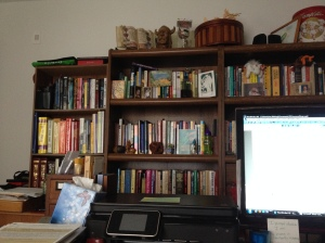 "Inspired while writing by ""wall of books"" and knick-knacks across the room."