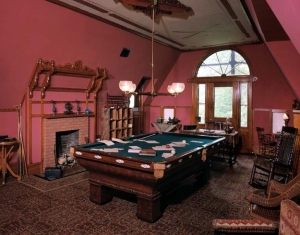 Twain's billiards table spread with papers
